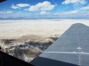 The view of the expansive Tularosa Basin as the plane flew from one mountain range to the other. Photo by Deb Schilling.